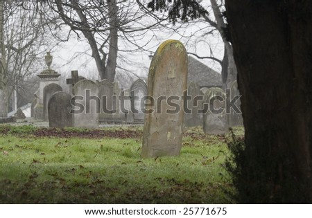 Tombstone in Burwell Cemetery, Cambridgeshire, England - stock photo