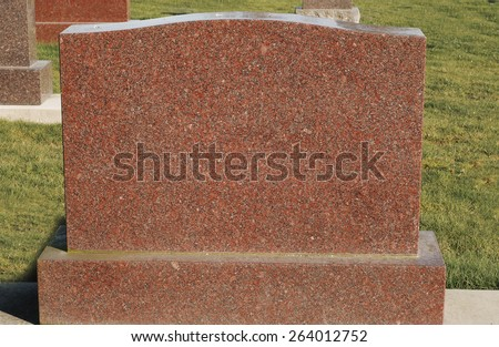 Tombstone in graveyard - stock photo
