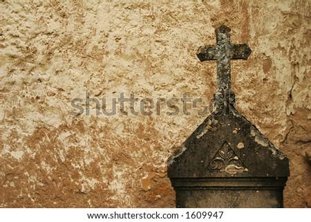 Tombstone with cross - stock photo