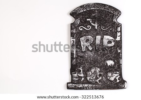 Tombstone with skull isolated on white background, copy space and clipping path. - stock photo