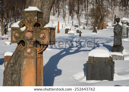 Tombstones covered by snow in an American cemetery - stock photo