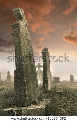 Tombstones on a stormy day, it was cold in the morning. - stock photo