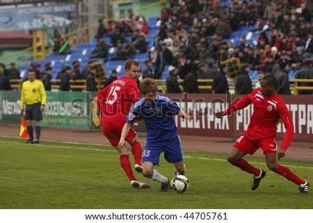 TOMSK, RUSSIA - APRIL 18: Football match Championship of Russia among Tom'(Tomsk) - Spartak (Nalchik), April 18, 2009 in Tomsk, Russia. - stock photo