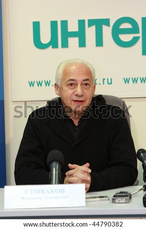 TOMSK, RUSSIA - DEC 4: Vladimir Spivakov - artistic director and chief conductor of the National Philharmonic Orchestra of Russia in agency Interfax-Siberia, December 4, 2009 in Tomsk, Russia. - stock photo