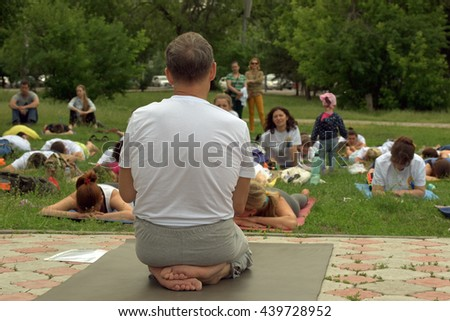 TOMSK RUSSIA - JUNE 19, 2016:: Residents of the city are taking part in the open lesson on Yoga in Central Park