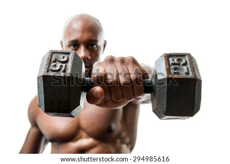 Toned and ripped lean muscle fitness man lifting weights isolated over a white background. Shallow depth of field. - stock photo