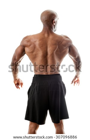 Toned and ripped lean muscle fitness man standing in front of a white background. - stock photo