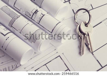 Toned and selective focus image. Bunch of keys on the house plan - stock photo