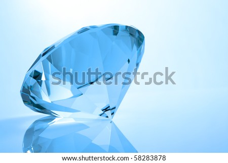 Toned backlit single diamond with reflection - stock photo