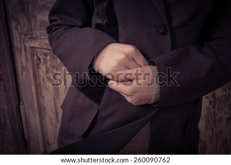 Toned closeup image of womens hands depression or loneliness concept - stock photo