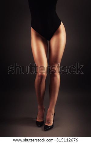 Toned elegant glamour young woman legs posing