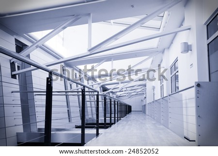 Toned image of empty corridor in modern office building - stock photo
