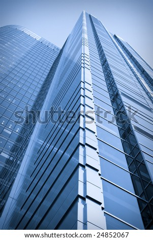 Toned image of very high office building made of glass and steel - stock photo