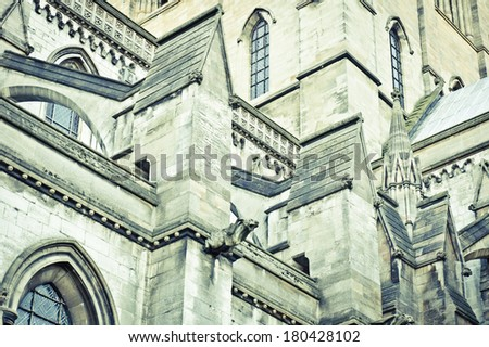 Toned image with a close up view of complex gothic architecture on Norwich Cathedral in England - stock photo