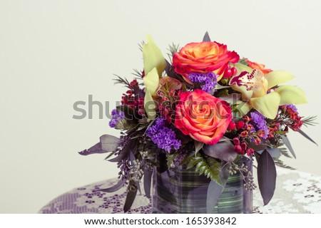 Toned imaged of flower arrangement. - stock photo