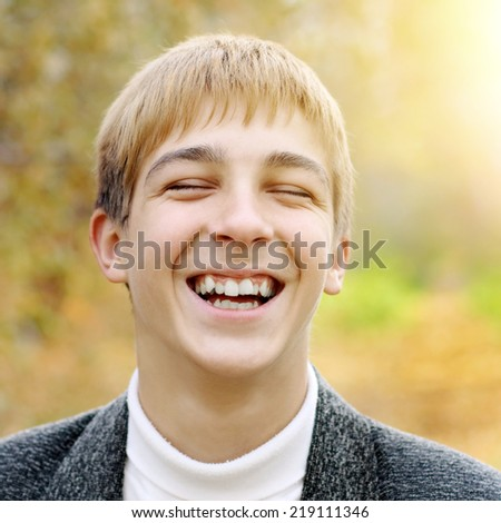 Toned photo of Cheerful Teenager in the Autumn Park