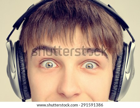 Toned Photo of Cheerful Teenager in the Headphones closeup - stock photo