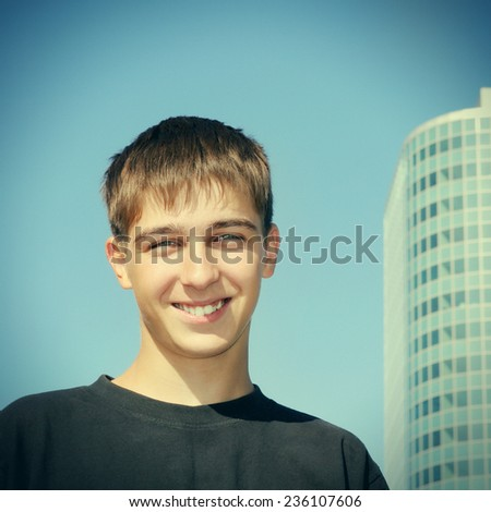 Toned Photo of Cheerful Teenager Portrait in the City - stock photo