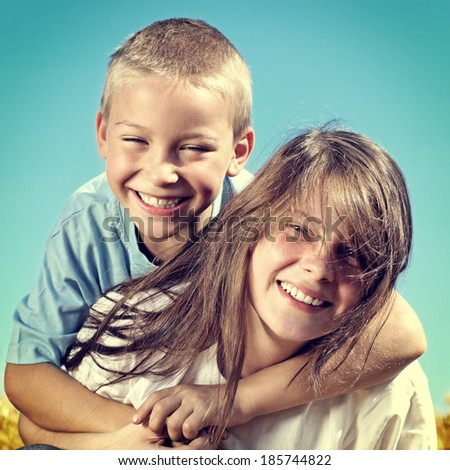 Toned photo of Happy Brother and Sister outdoor - stock photo