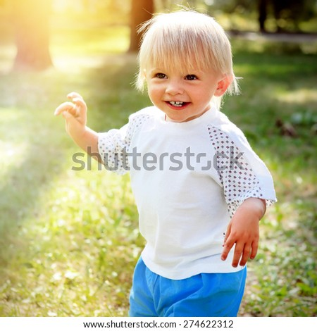 Toned Photo of Happy Child in the Summer Park