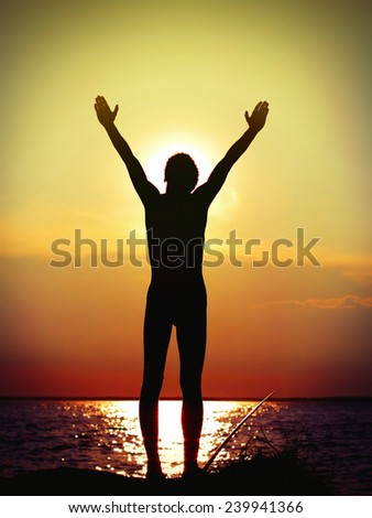 Toned Photo of happy person silhouette on sunset background - stock photo