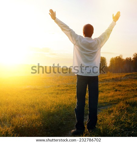 Toned Photo of Happy Teenager with Hands Up on the Nature background - stock photo