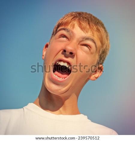 Toned photo of Happy Teenager yell outdoor - stock photo