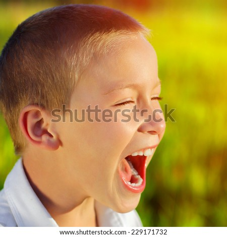 Toned photo of Kid Yell outdoor - stock photo