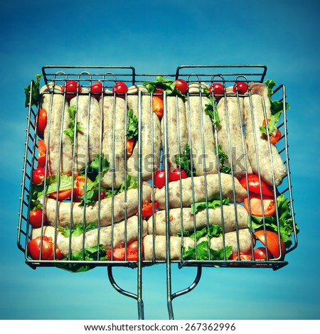 Toned Photo of Sausage Grill on the Blue Sky Background - stock photo