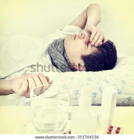 Toned Photo of Sick Young Man sleep on the Bed with Pills on the Foreground - stock photo