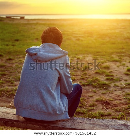 Toned Photo of the Lonely Man at Sunset
