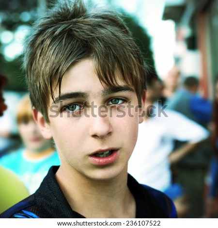 Toned Photo of Worried Teenager Portrait on the City Street - stock photo
