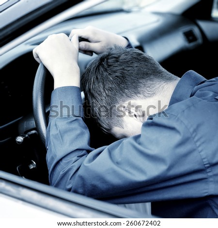 Toned Photo of Young Man sleep in the Car