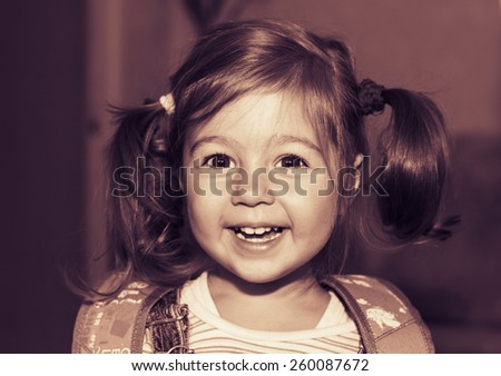 Toned portrait of happy pretty little girl smiling - stock photo