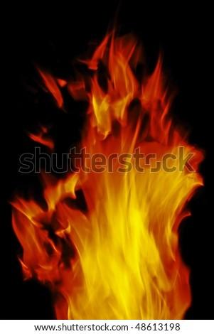Tongue of orange flame isolated on black background - stock photo