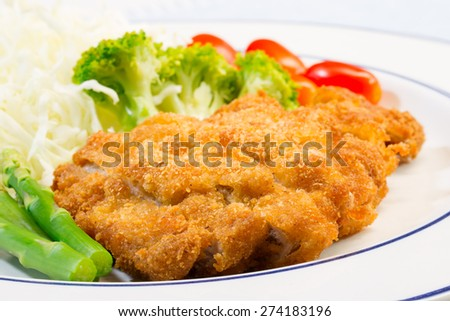 Tonkatsu (Fried pork) and vegetable, on white plate
