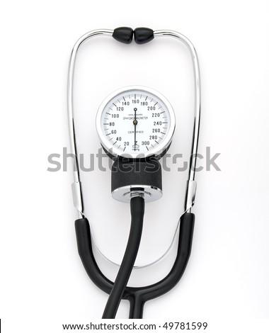 tonometer lying on white surface - stock photo