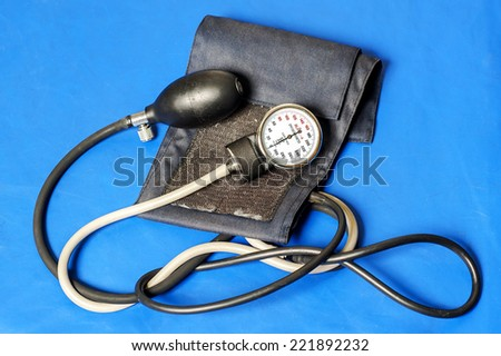 tonometer on a blue background, isolated  - stock photo