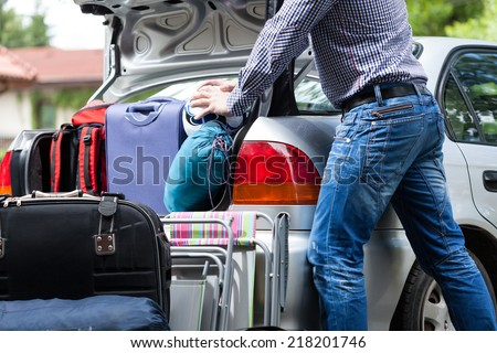Too little car trunk for family luggage - stock photo