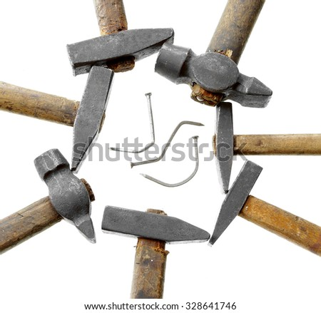 too many cooks spoil the broth proverb batch of hammers damaged nail isolated on white background - stock photo