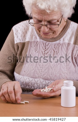 Too many pills to take isolated in black background