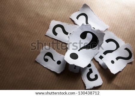 Too many question marks on striped paper - stock photo