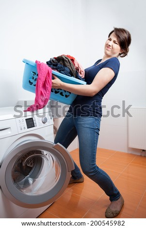 Too much to launder in domestic laundry - stock photo