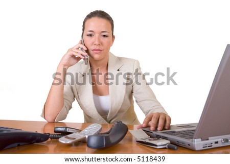 Too much work!. Pretty young woman with too much work to do on the phone - over a white background