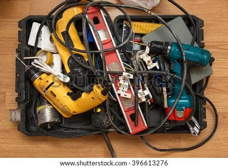 Tool box of carpenter on the floor - stock photo