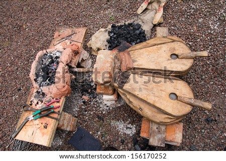 tool for inflating the fire in the furnace - stock photo