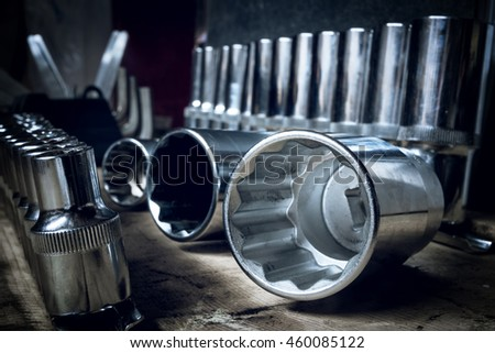 Tool head against the background of a similar tool with shallow depth of field