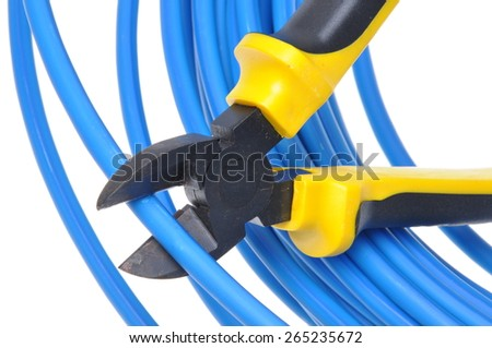 Tool pliers cutting blue cable isolated on white background - stock photo