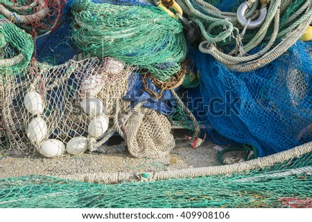 Tool, rigs and fishing nets with a port in Mallorca, Spain. Detail of wires and cords - stock photo