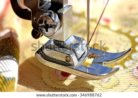 Tool tailor on yellow fabric - stock photo